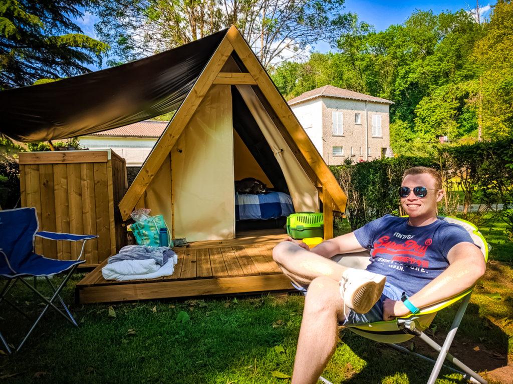 Mike lovatt sat outside our tente randonneur at Camping des Ribières