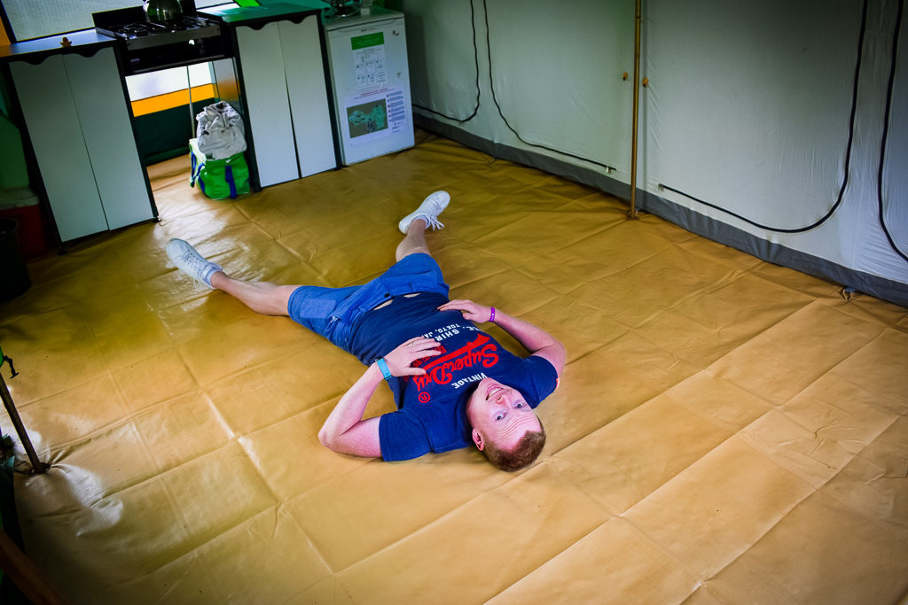 mike lying on the floor in eurocamp classic tent
