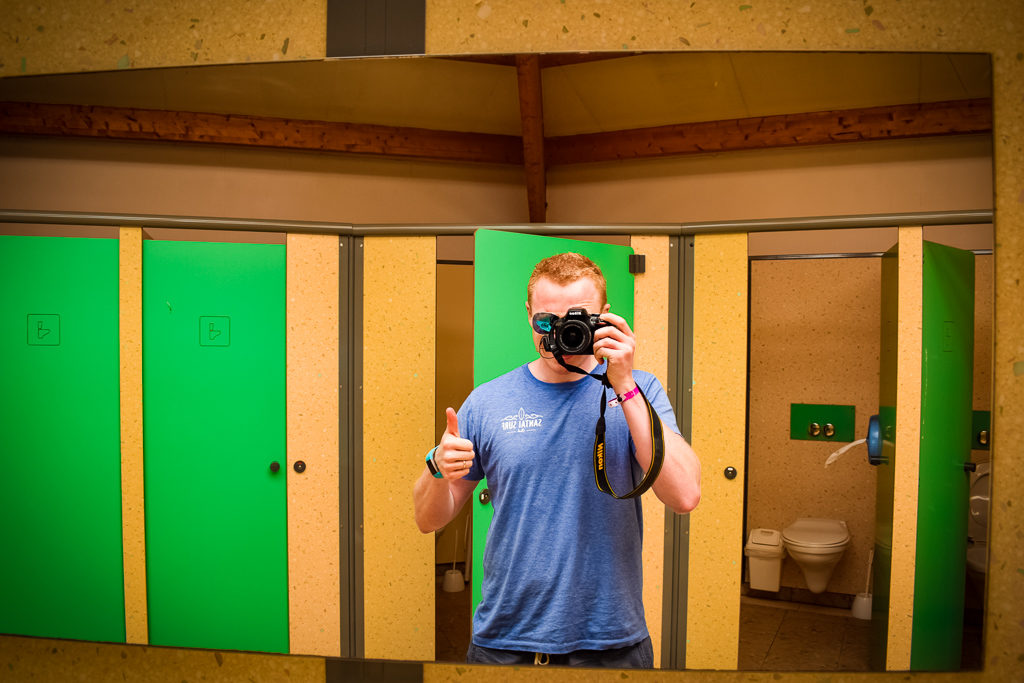 mike taking a selfie in saint avit loisirs toilet block