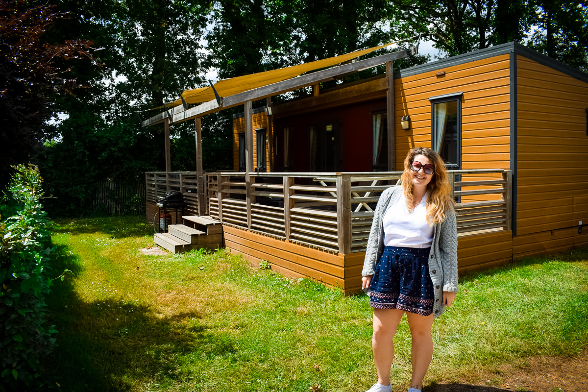 Breanne outside the Aspect mobile home by Eurocamp at camping la Garangeoire