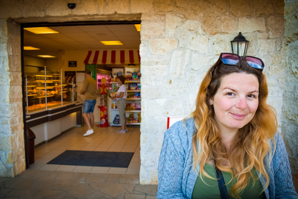 Breanne sat outside the bakery at La Croix du vieux pont berny riviere france (17)