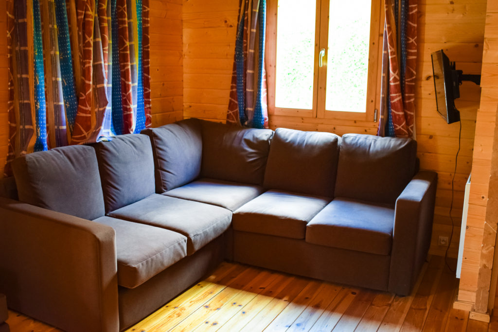 Sofa area of the 4 bedroom villa lodge at la croix du view pont campsite with eurocamp in the village of berny riviere france