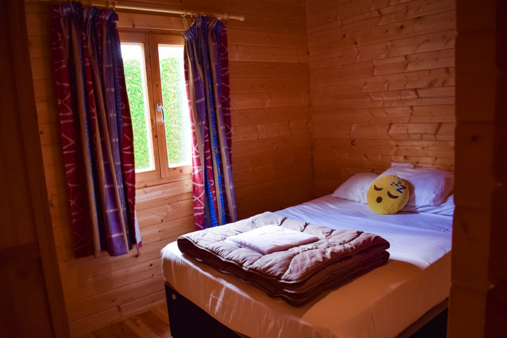 downstairs double bedroom in the wooden 4 bed villa lodge from eurocamp at la croix du vieux pont berny riviere