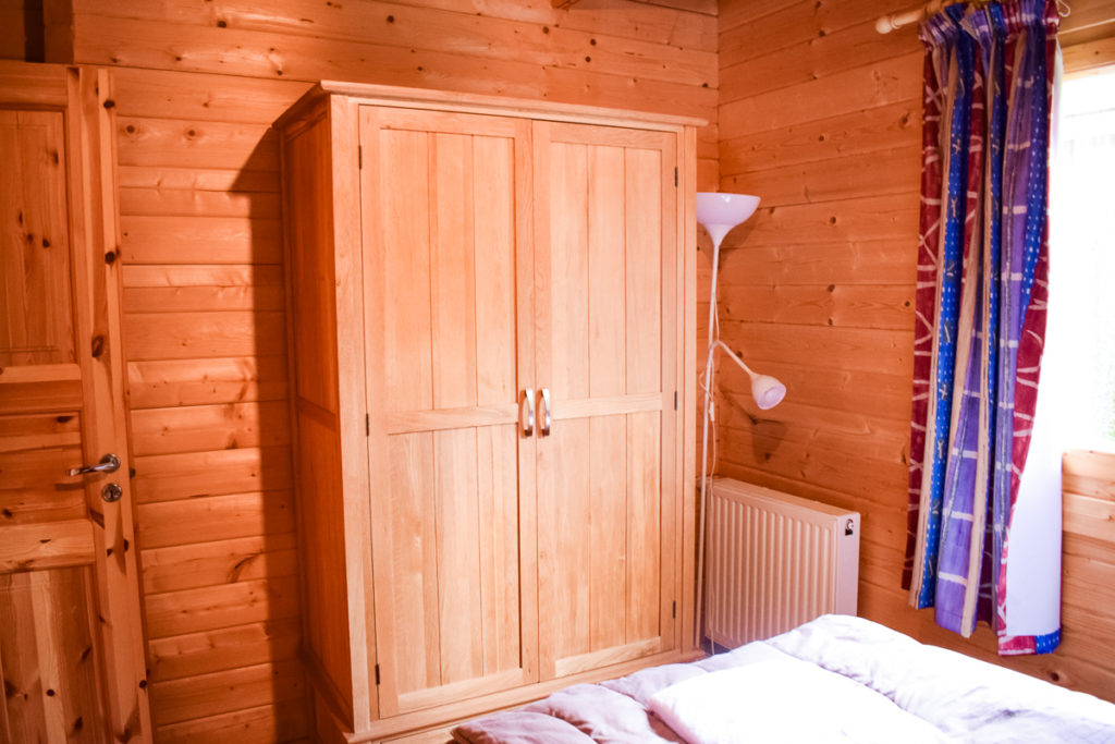Wardrobe in the downstairs double bedroom of the wooden 4 bedroom villa lodge at la croix du vieux pont in berny riviere with eurocamp