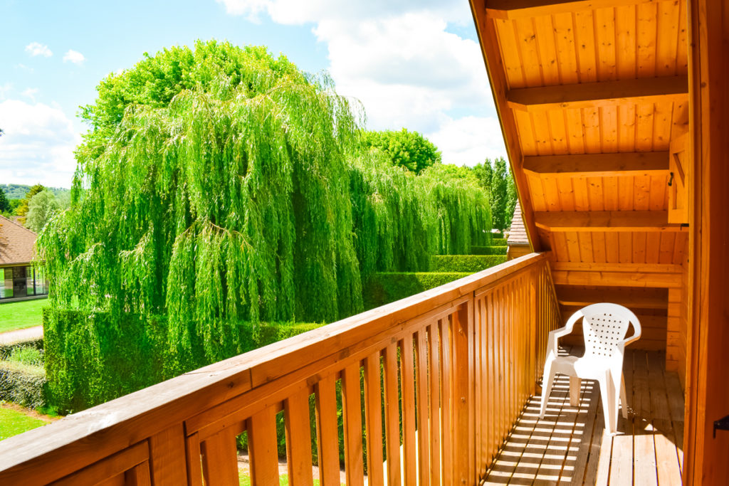 Balcony from the main upstairs bedroom at eurocamp la croix du vieux pont berny riviere