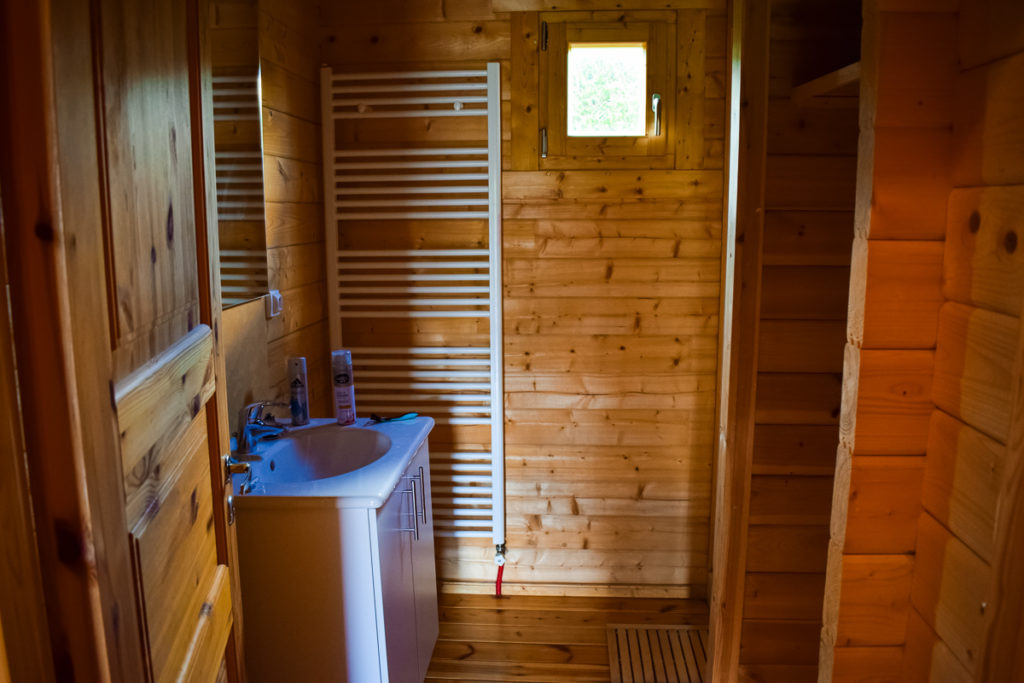 downstairs shower room with walk in shower in the 4 bedroom wooden lodge from eurocamp at la croix du vieux pont berny riviere campsite