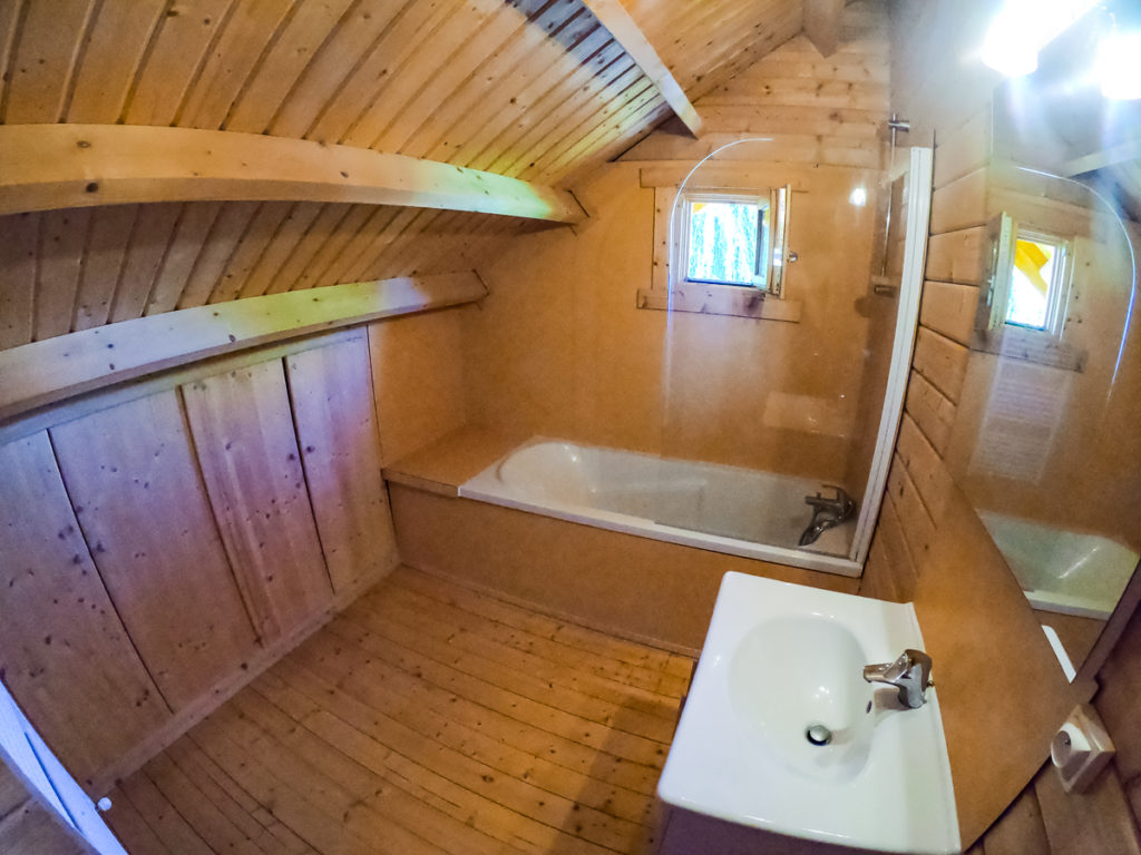 Bathroom upstairs with actual bathtub at la croix du vieux pont campsite in berny riviere. Inside the 4 bedroom wooden lodge from eurocamp