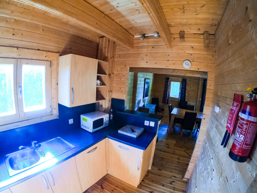 GO pro fish eye photo from inside the kitchen in the 4 bedroom wooden villa lodge at la croix du view pont camping