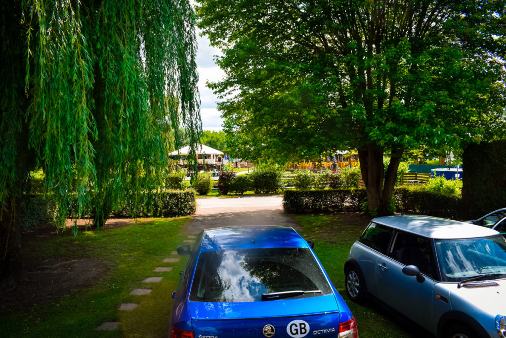 The parking situation on our lodge pitch at La Croix du vieux pont berny riviere france we fit 3 cars on the emplacement and still had plenty of space
