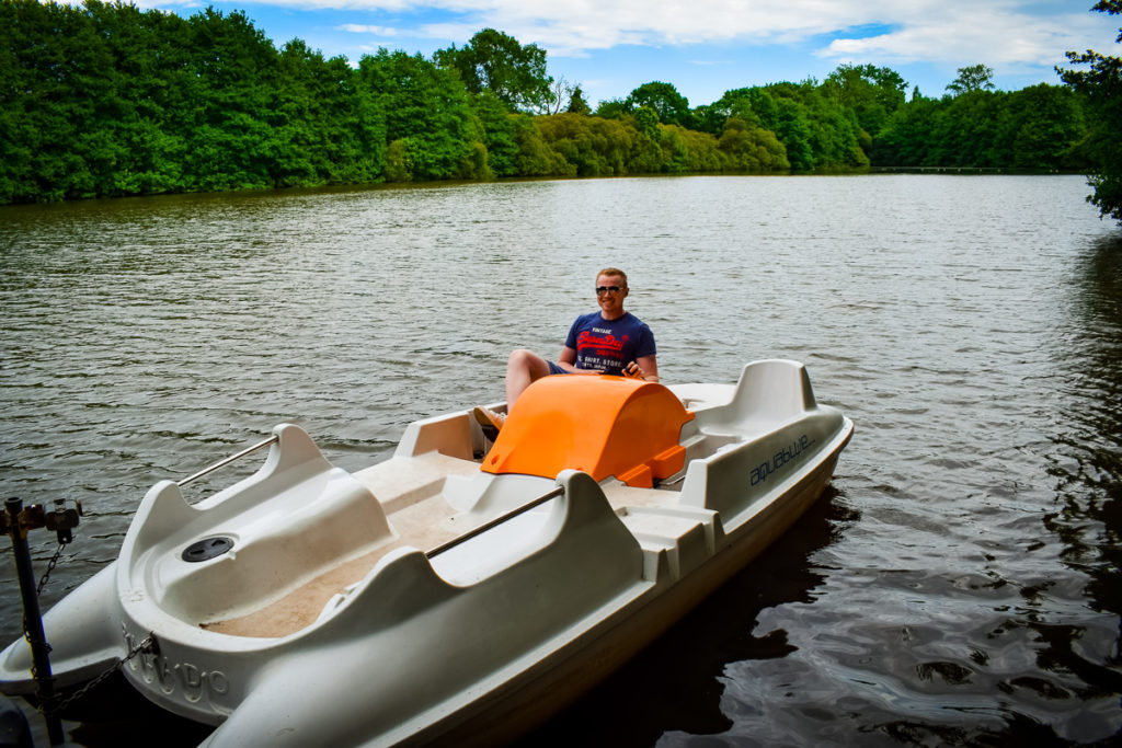 a pedalo with mike sat on it at the lake at la garangeoire