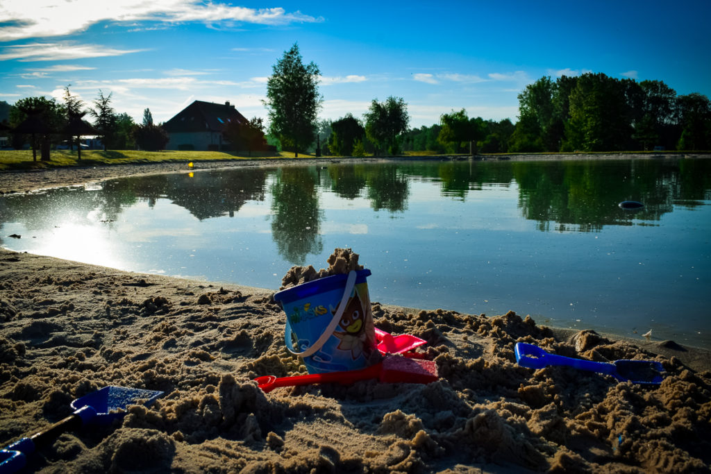 bucket and spade on the beachfront of the beach lake at La Croix du vieux pont berny riviere france (24)