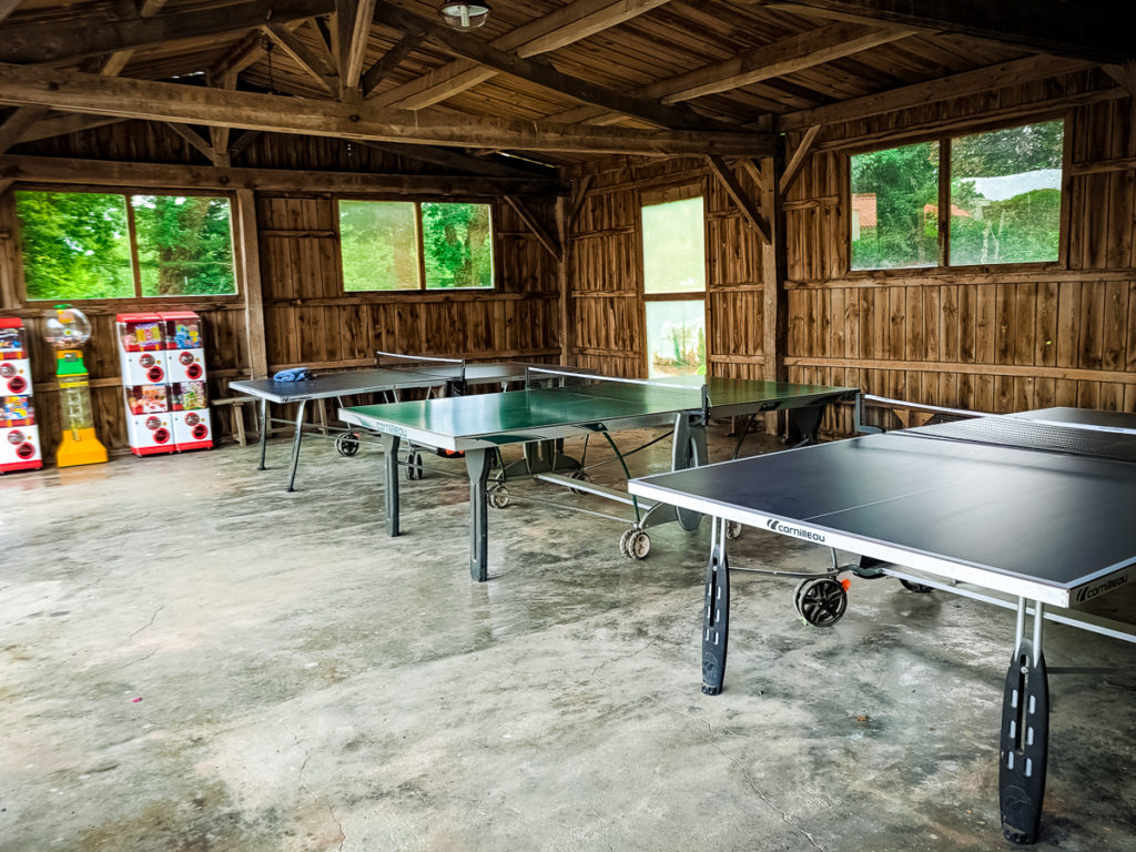inside table tennis under bike shed cover at castels camping la garangeoire