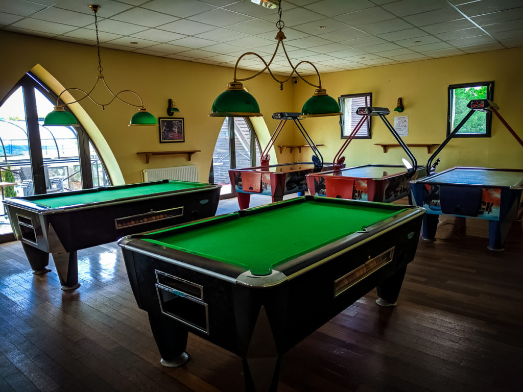 pool or billiards and mini arcade with air hockey upstairs in the summer bar at camping La Croix du vieux pont berny riviere france (49)