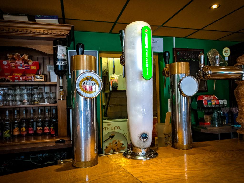 the bar area inside the summer bar of La Croix du vieux pont berny riviere france (48)