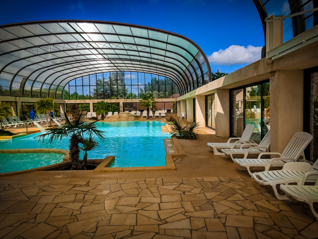 the indoor pool area with retractable roof at La Croix du vieux pont berny riviere france (63)