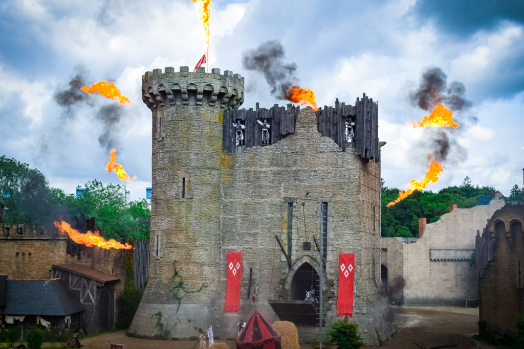 the shows at Puy du Fou with fire and people climbing walls