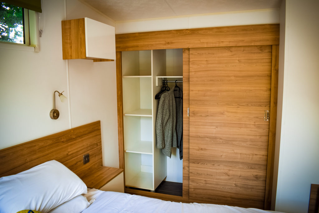 sliding doors storage space wardrobes in the aspect mobile home by eurocamp