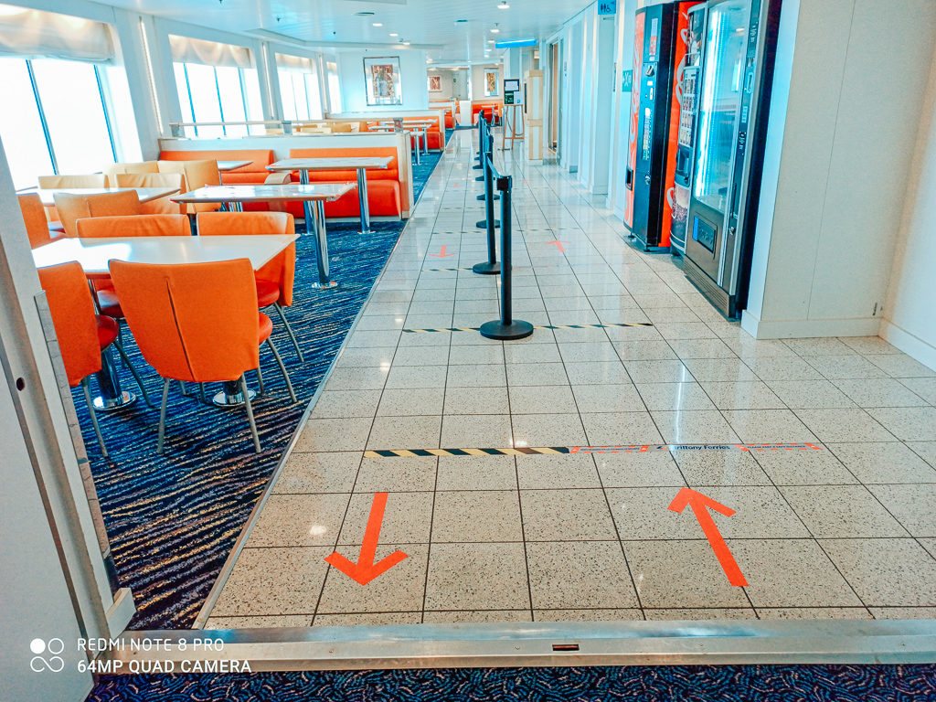 arrows directing the flow of passengers on board the Brittany Ferries post lockdown crossing between caen and portsmouth