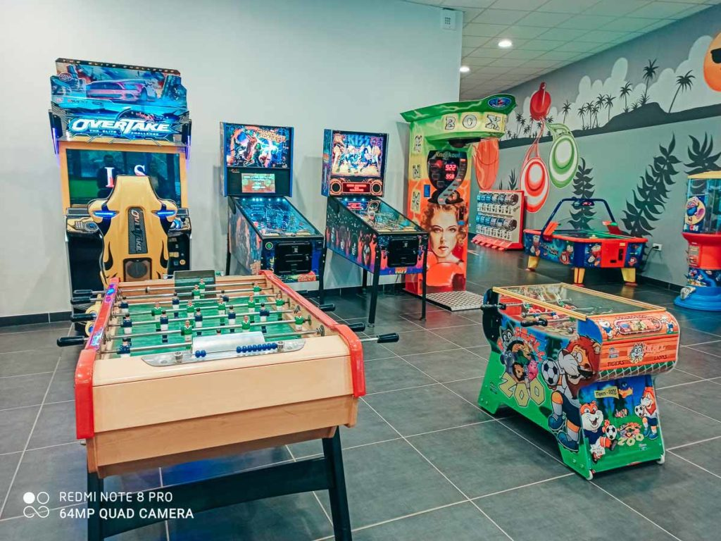another arcade room photo featuring table football and other games Camping de l'ocean Brem Sur Mer
