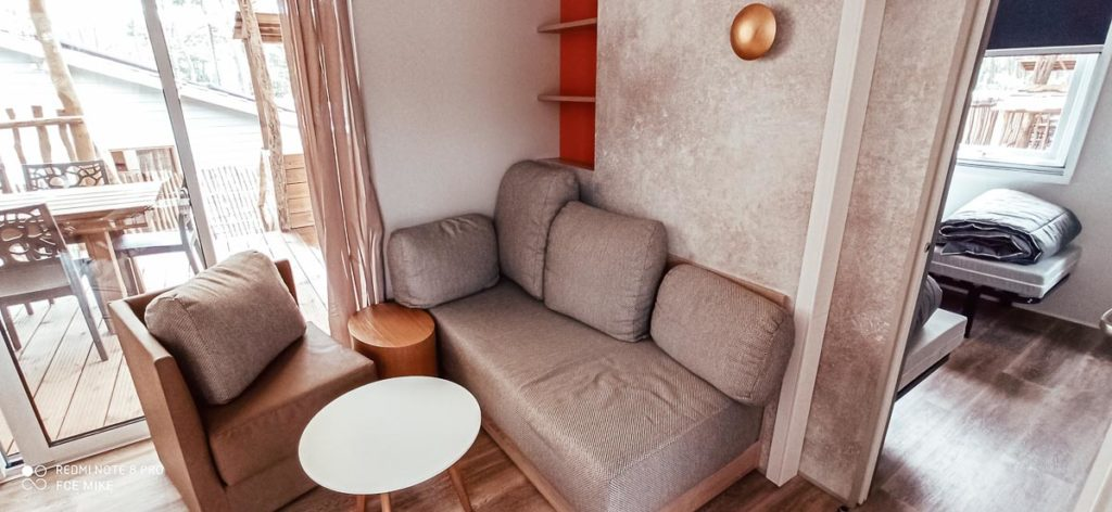 Living room sofa in our 4p premium lodge mobile home accommodation at Camping le Vieux Port Landes france