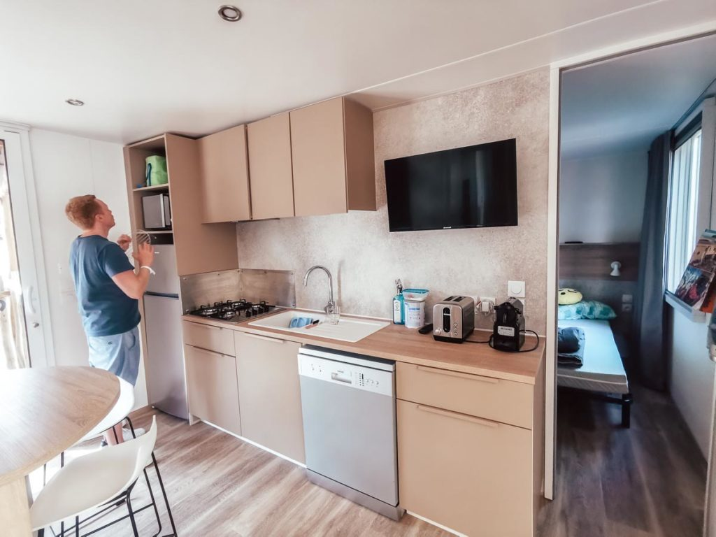 Mike stood in the kitchen in our 4p premium lodge mobile home accommodation at Camping le Vieux Port Landes france
