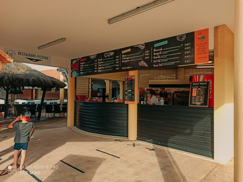 The pizza stall and menu list at camping le vieux port by Resasol in Messanges, Landes department, France