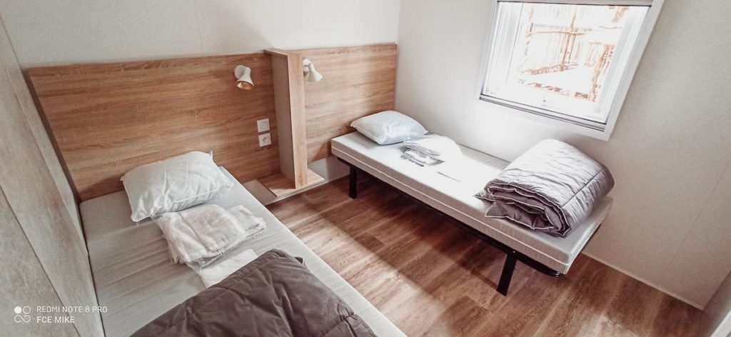 Twin Bedroom in our 4p premium lodge mobile home accommodation at Camping le Vieux Port Landes france