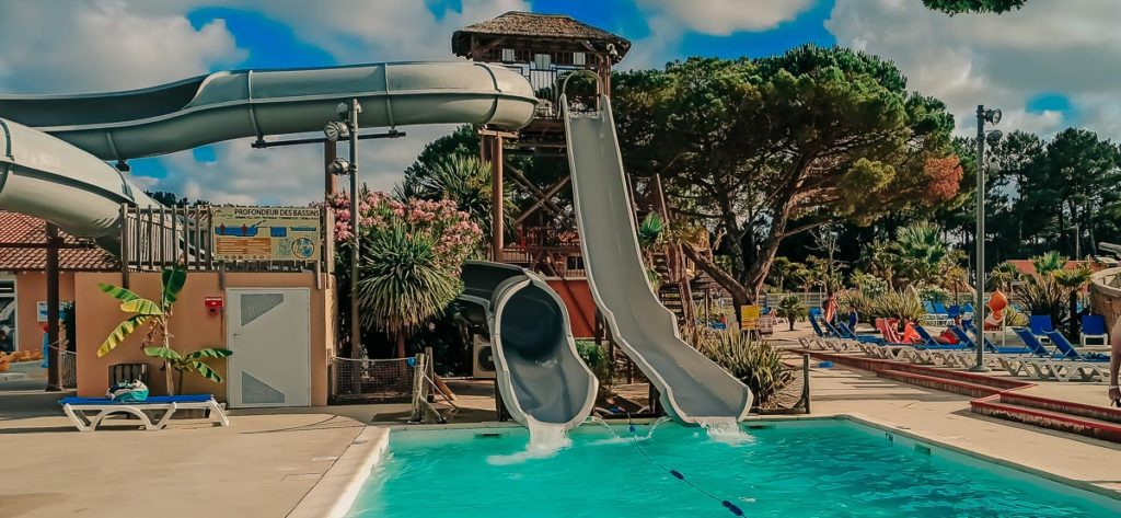waterslide exit pool at The pool area at camping le vieux port by Resasol in Messanges, Landes department, France