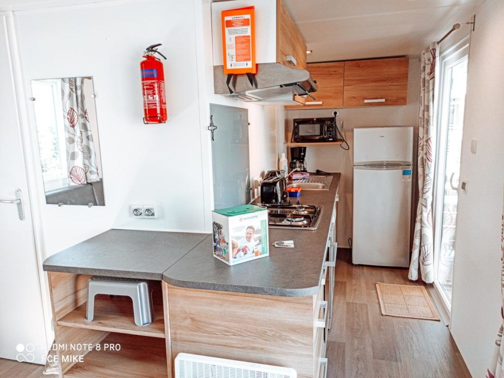 Kitchen in our Azure Plus 2 bedroom from Eurocamp at Camping des menhirs-11