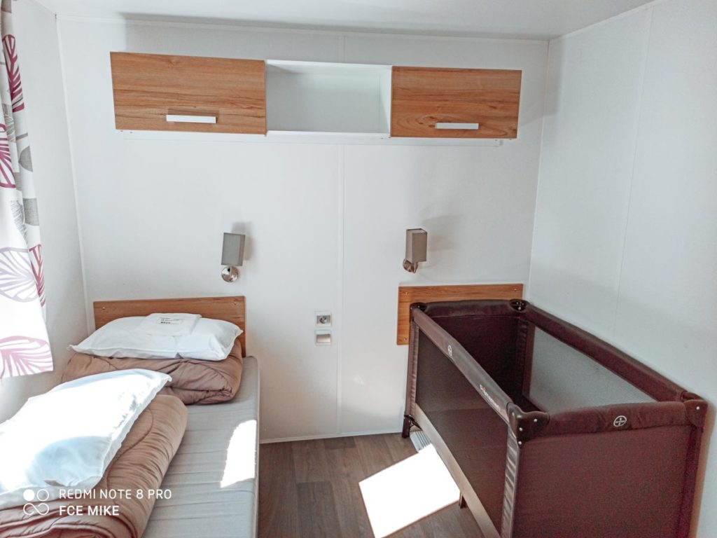 twin bedroom in our Azure Plus 2 bedroom from Eurocamp at Camping des menhirs