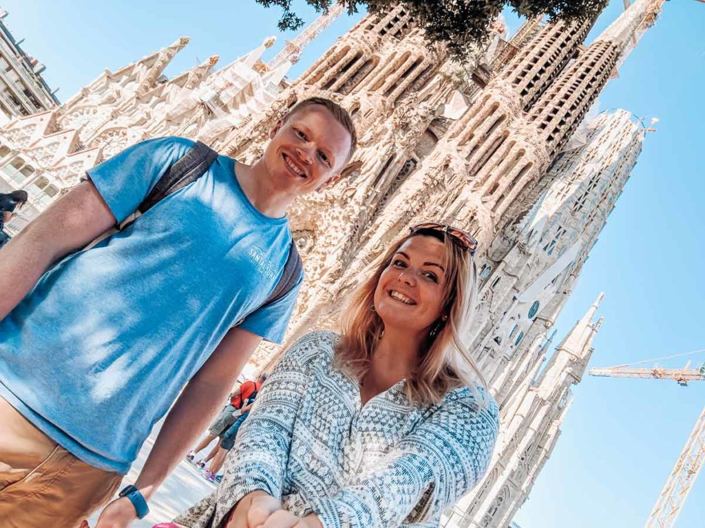 Breanne and Mike at the Sagrada Familia in Barcelona for the things to do in barcelona blog