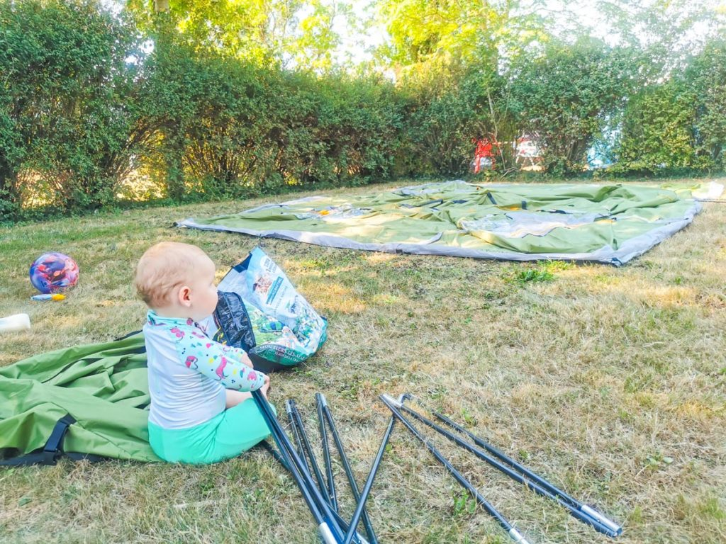 Baby building a tent at Mansle campsite in the Charente France.