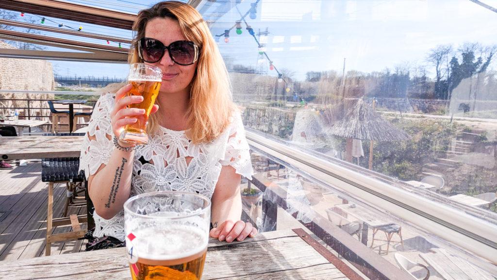 breanne drinking beer at marche du lez in montpellier
