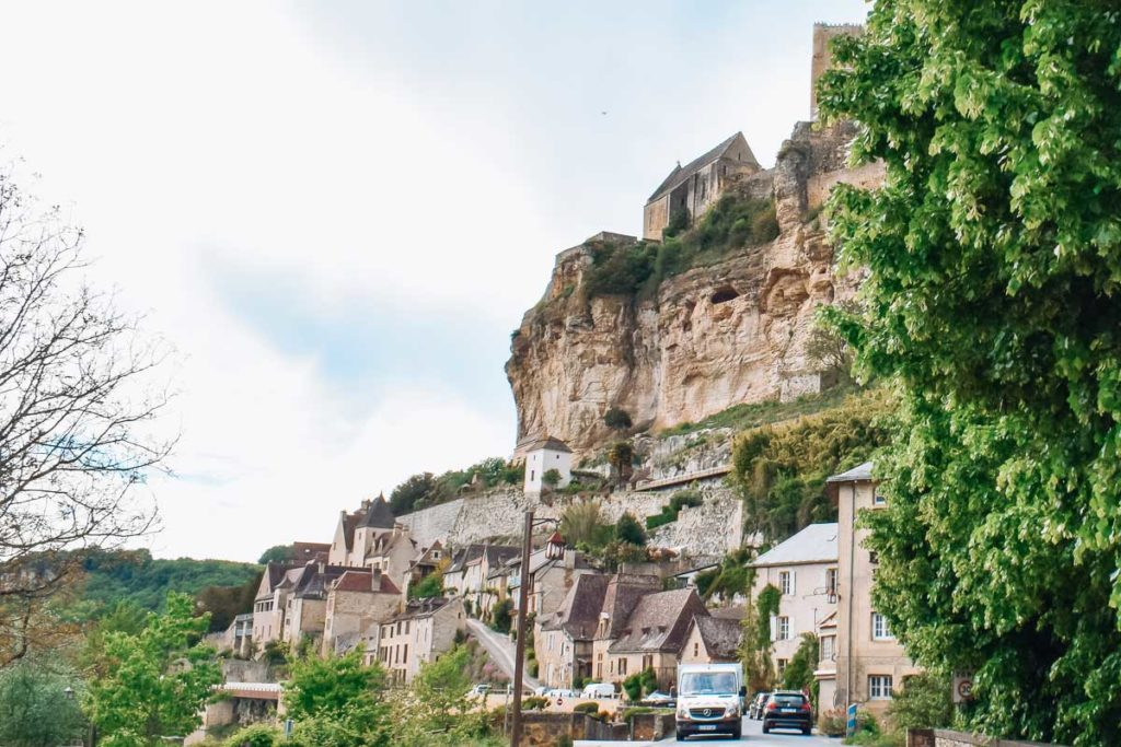 Castle on the hill in beynac et cazenac in the dordogne to show the landscape of the village