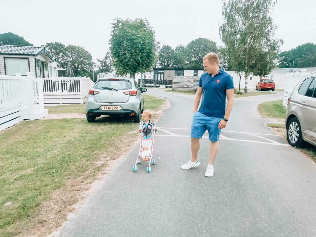 Mike-and-the-toddler-walking-down-the-road-at-Hoburne-bashley-holiday-park