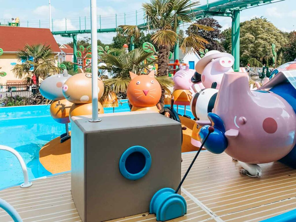 Paultons-park-and-peppa-pig-world photo from granpa pigs sailing club of grandpa pig lying on a boat and other characters in the background