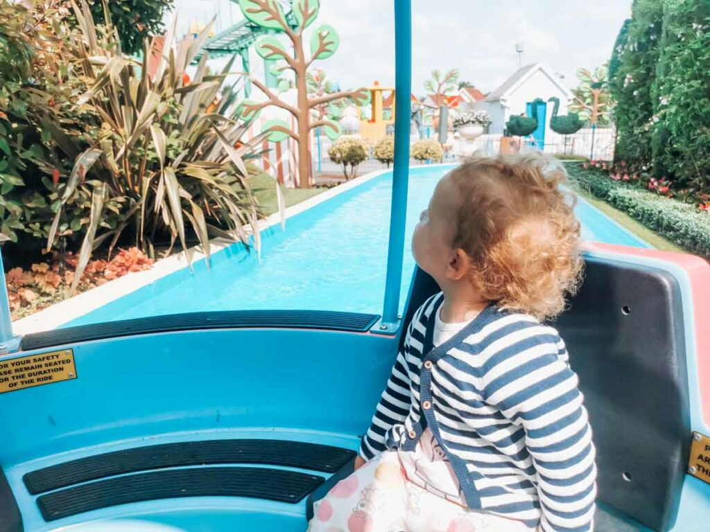 toddler on the grandpa pig ride at Paultons-park-and-peppa-pig-world