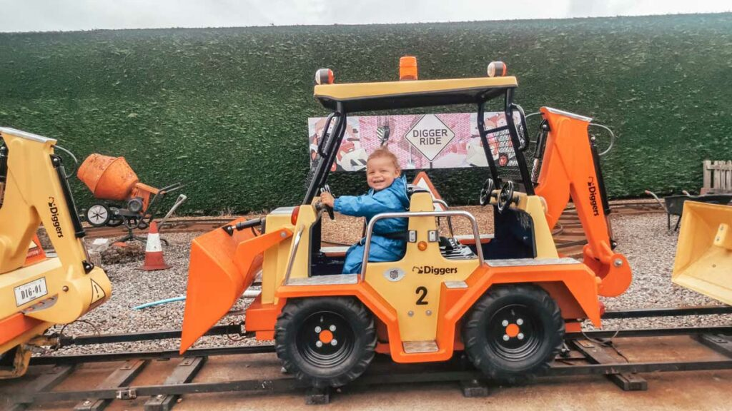 toddler on the digger ride at Paultons-park-and-peppa-pig-world
