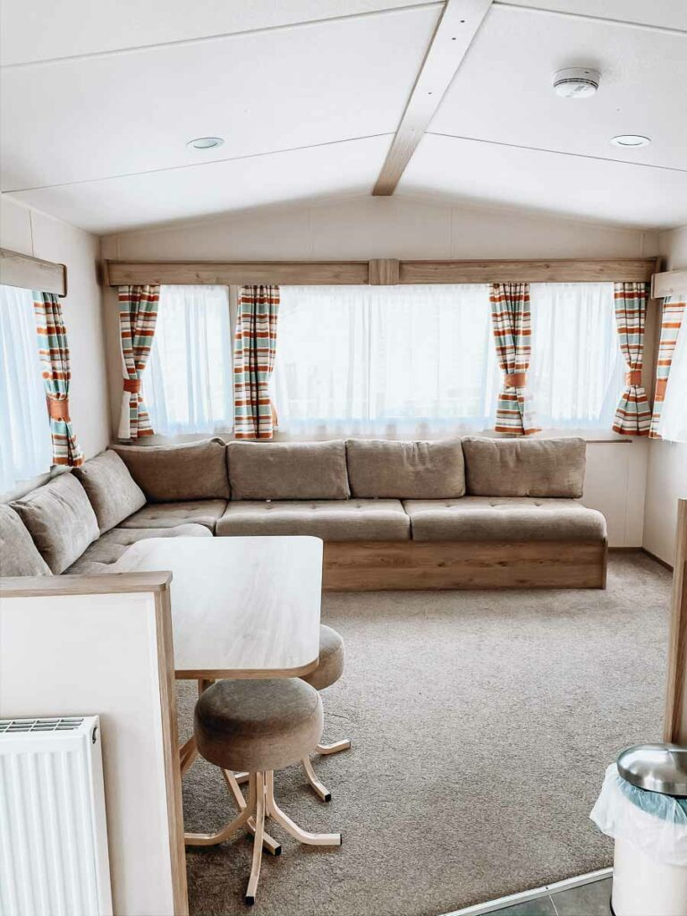 seating-area-with-windows-in-a-classic-caravan-at-hoburne-bashley-holiday-park