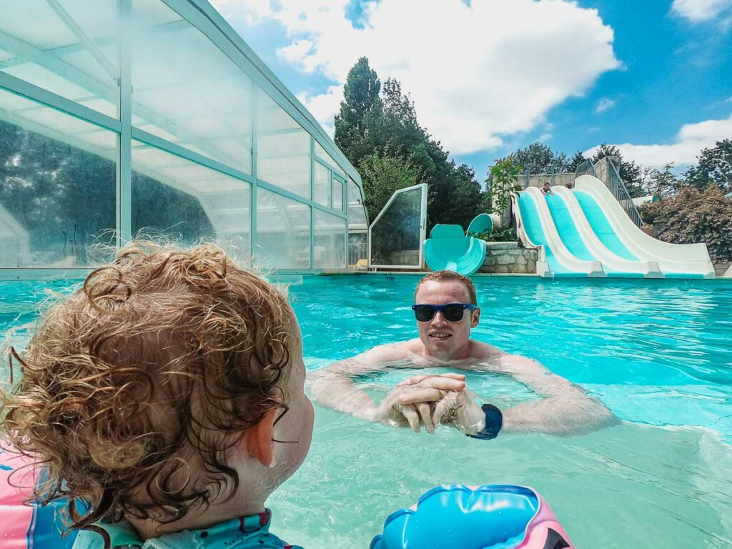 Mike-and-the-toddler-at-the- slides pool-on-domaine-de-la-breche-campsite