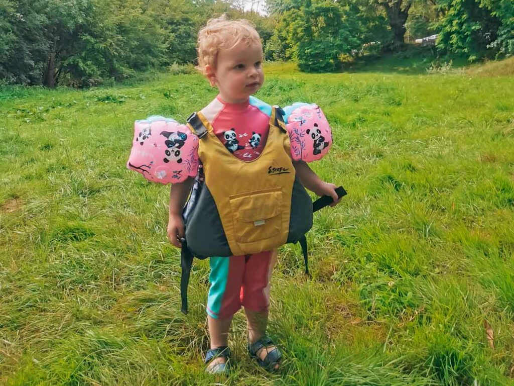 The toddler in her oversized life jacket at yelloh village la roche posay