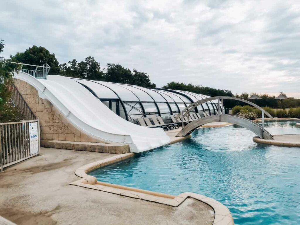 The 3 fast water slides into the water pool at yelloh village la roche posay