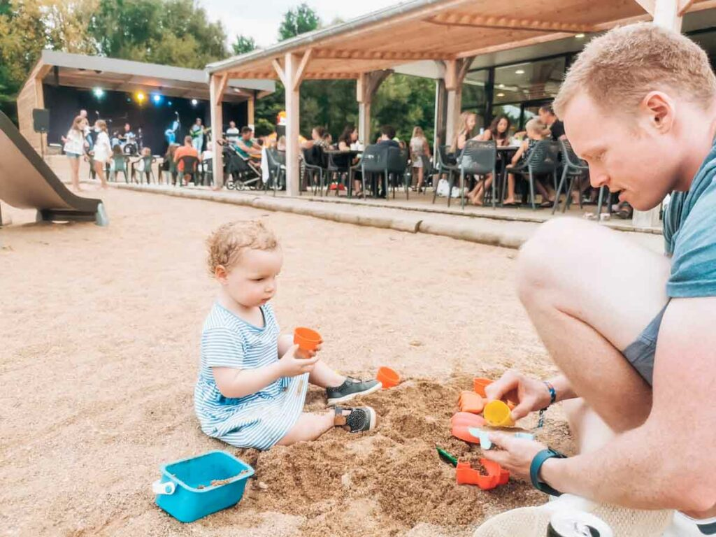 Mike and the toddler digging in the play sant at camping la roche posay