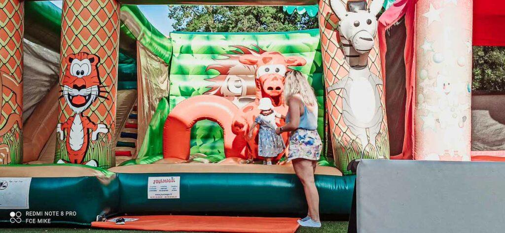 toddler-on-a-bouncy castle-at-domaine-de-la-breche-campsite