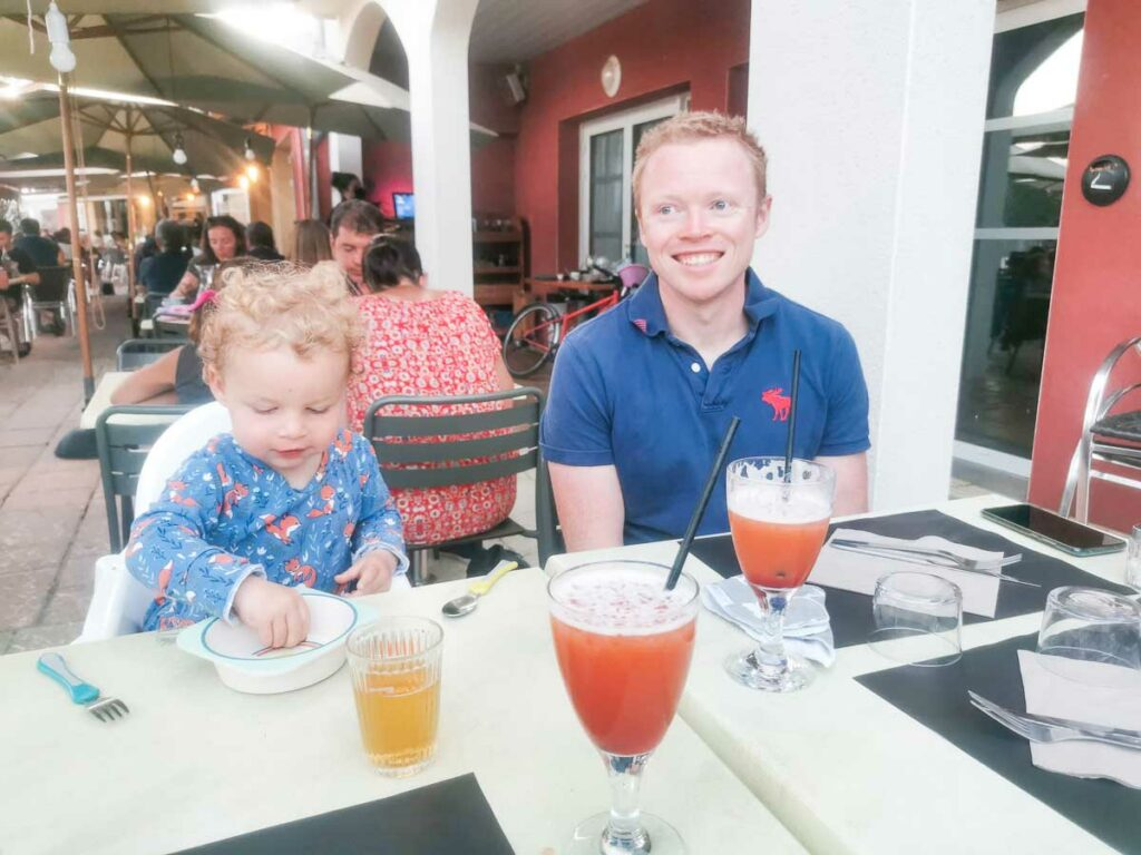 Mike-and-the-toddler-waiting-at-sylvabar-restaurant-with-drinks-on-the-table