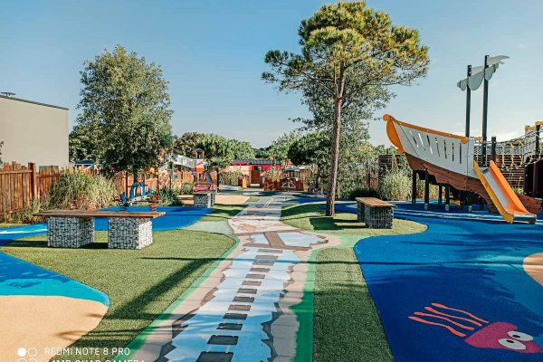 new outdoor play area with fun coloured and patterned floor at Camping de l'ocean Brem Sur Mer